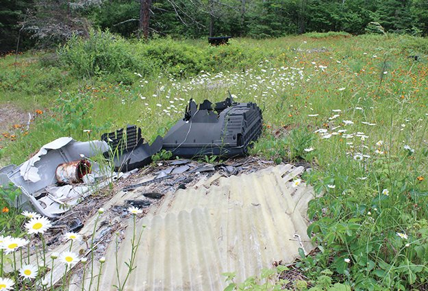 Tossed appliances, old paint cans, and other junk sits alongside Forest Rd. 757 on the Laurentian District. Illegal dumping is a significant issue on the Superior National Forest.