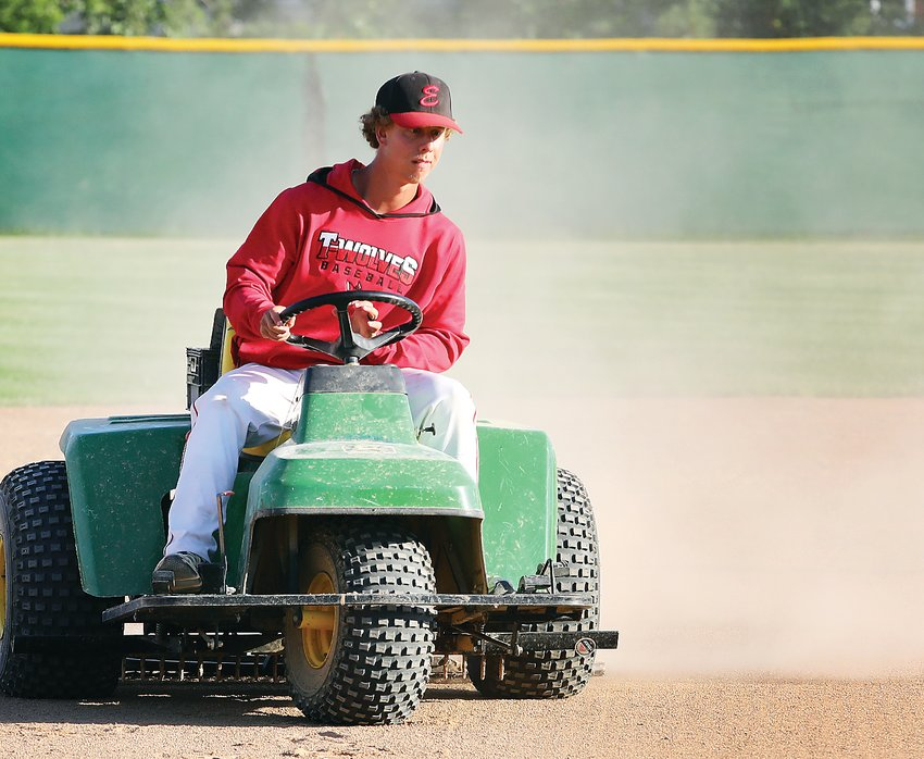 Groundskeeper Max Gantt preps the Ely field ahead of this   weekend's big event.