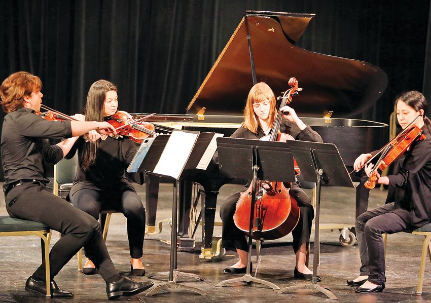 A string quartet from the Northern Lights Music Festival performed recently in the fine arts theater at Vermilion Community College in Ely.