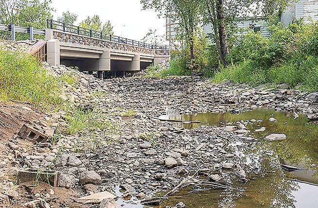 A nearly dry Littlefork River trickled under Cook's River Street bridge this week.