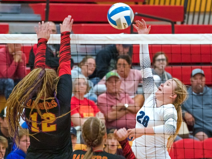 Abbigail Shuster fires a kill down the sideline for the Grizzlies.