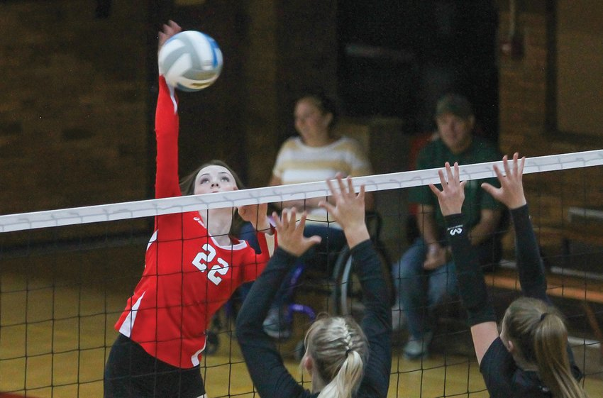 Ely's Madeline Kallberg goes up for a kill during Tuesday's contest with Northeast Range.