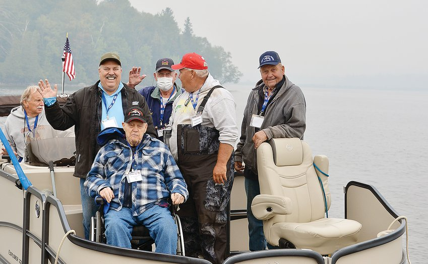 A pontoon boat full of vets headed out on Lake Vermilion last Thursday, led by longtime guide Rob Bryers (in red hat).