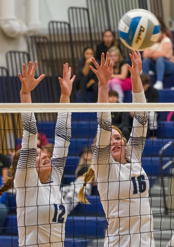 Karah Scofield and Addy Hartway (#16) team up to defend at the net.