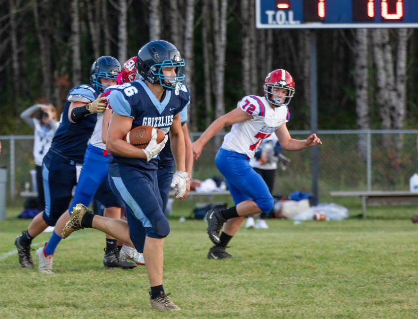 he   Grizzlies'    TJ Chiabotti heads for the end zone after   intercepting a first quarter Chisholm pass. It was the first of seven touchdowns for Chiabotti in the game.