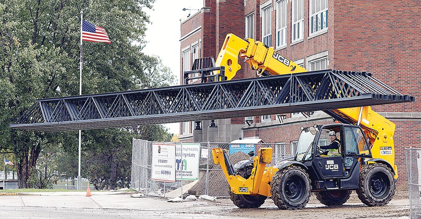 Steel roof truss components were delivered to the Ely school building project last week. Look for a 350-ton crane to start placing precast wall panels next week.