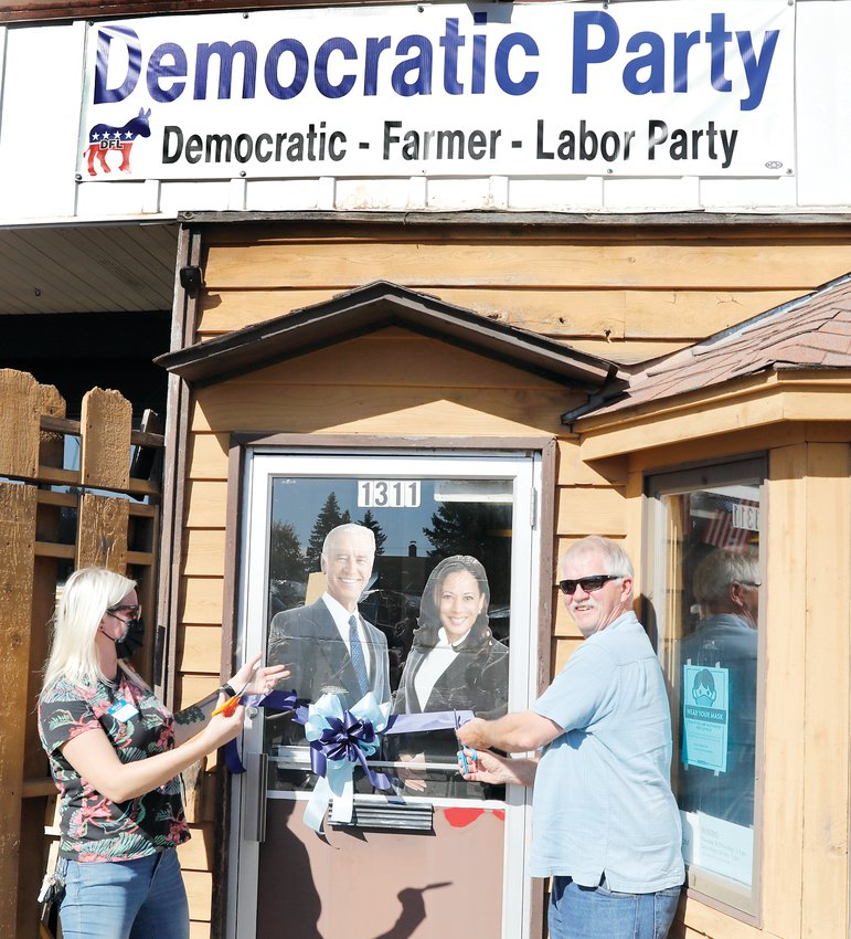 Minnesota DFL Political Director Alyse Maye Quade, and State Rep. Rob Ecklund cut a ribbon to officially open the DFL office in Ely on Sunday.