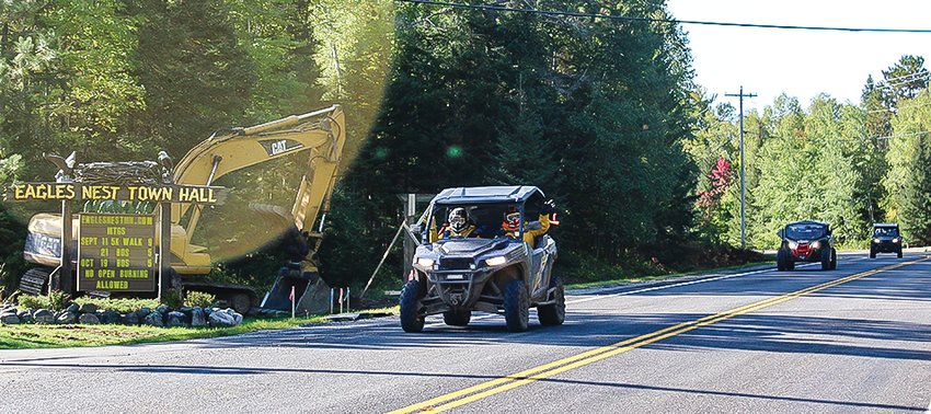 ATVs drove along the Bear Head State Park Road past the Eagles Nest Town Hall during the recent Ride and Rally sponsored by the Prospectors Trail ATV Club and the ATV Association of Minnesota.