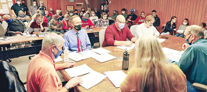 The ISD 696 board room was standing room only Monday night for the monthly business meeting of the Ely school board as COVID-19 public health mitigation strategies were discussed.