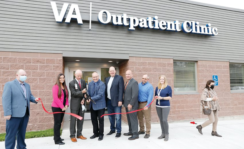 Patrick Kelly, Minneapolis Veterans Affairs Health Care System Director, cuts a ribbon with VA clinic staff and area elected officials at the newly-renovated and expanded VA Clinic in Ely.