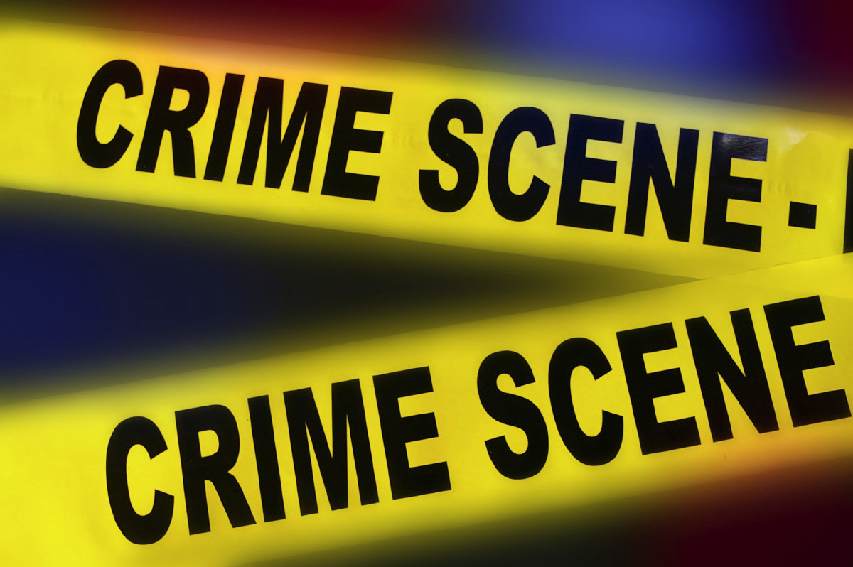 50928053 - yellow police crime scene tape on red and blue background