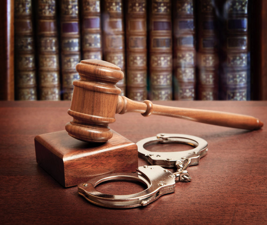 47523877 - gavel and handcuffs on wooden background