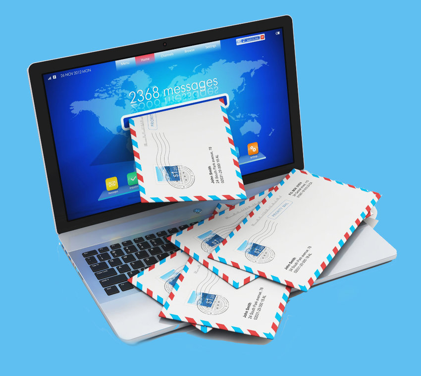 16117895 - heap of letters in envelopes falling from screen of modern metal office laptop or silver business notebook