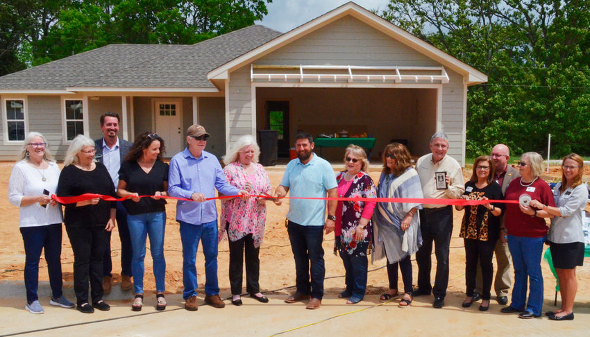 City officials joined builder Peter Woolford, members of the Blackmon family and real estate agents for a ribbon cutting at Blackmon Meadows last Wednesday in Mineola.
