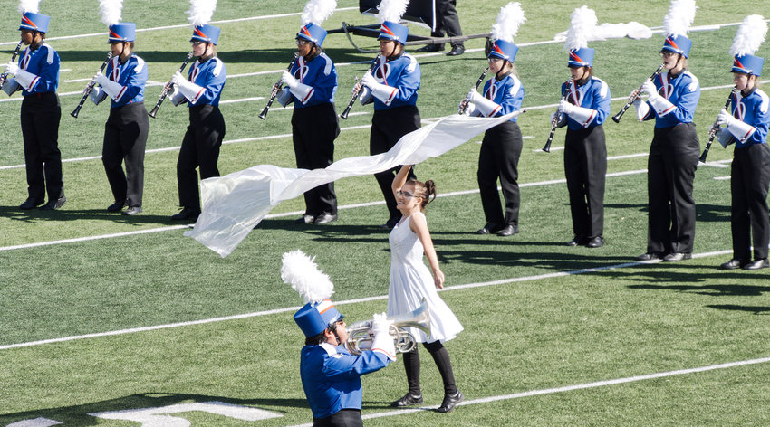 Whitnee Weiher performs a flag solo during Quitman's performance at the UIL Region 4 marching band competition in Texarkana on Tuesday.