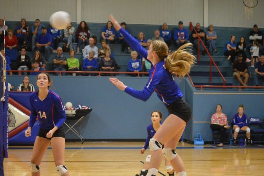 Jentri Jackson (2) slams one for a score as Ava Burroughs (14) looks on against Rains in Quitman's win last week.