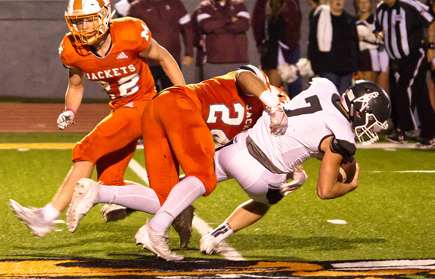 Kobe Kendrick (24) makes the tackle for Mineola in Friday's 44-7 win over White Oak.