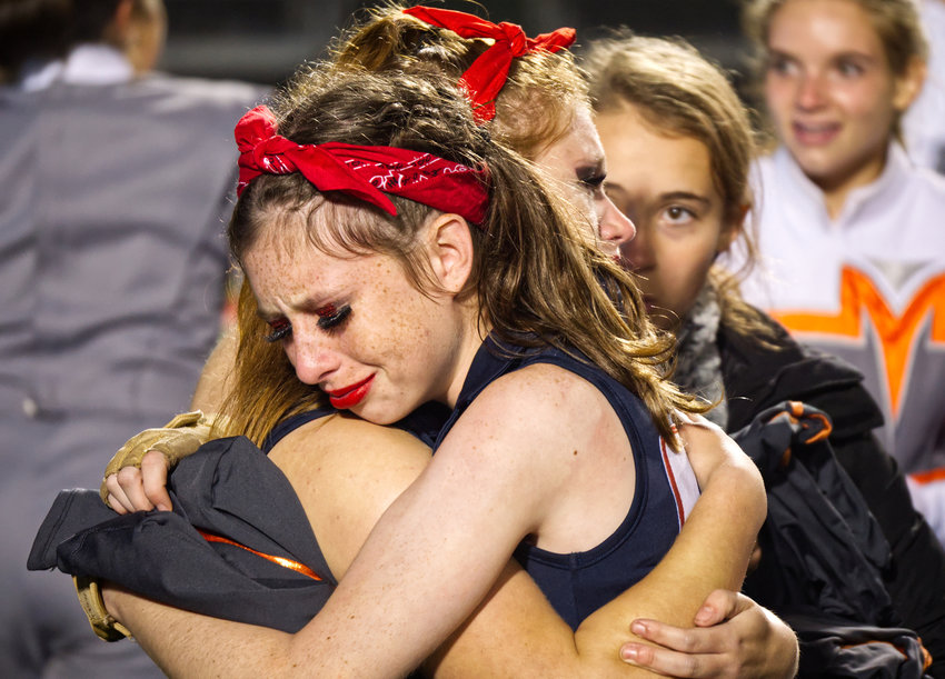 Colorguard members Jenna Haggerton and Adrian French embrace, overjoyed after winning the area marching contest Saturday in Carthage.
