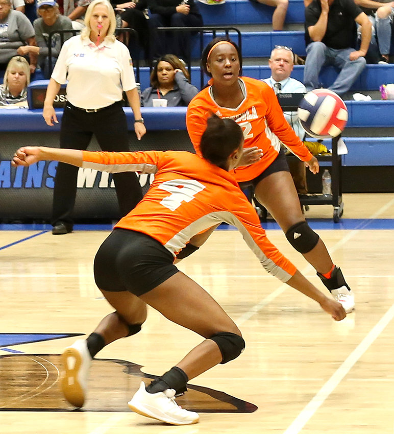 Mineola's Tahjae Black and Tiara Stephens react to a drop shot in action against Rains.