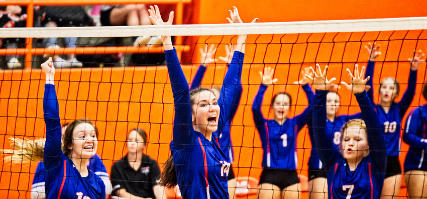 Lucy Brannon, Ava Burroughs and Shelby Hayes celebrate a point in Quitman's favor.