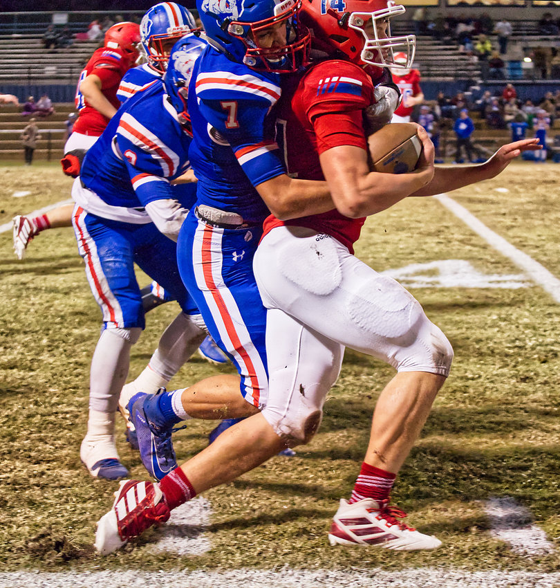 Quitman's Ben Burroughs (7) battles to bring down Alba-Golden's John Michael Chadwick in Friday's game. The Panther senior scored twice against the Bulldogs in the Panthers 26-0 win.