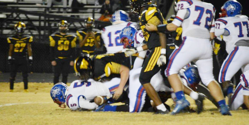 Ty Holland is finally brought down by a Winona defender in Friday's battle.