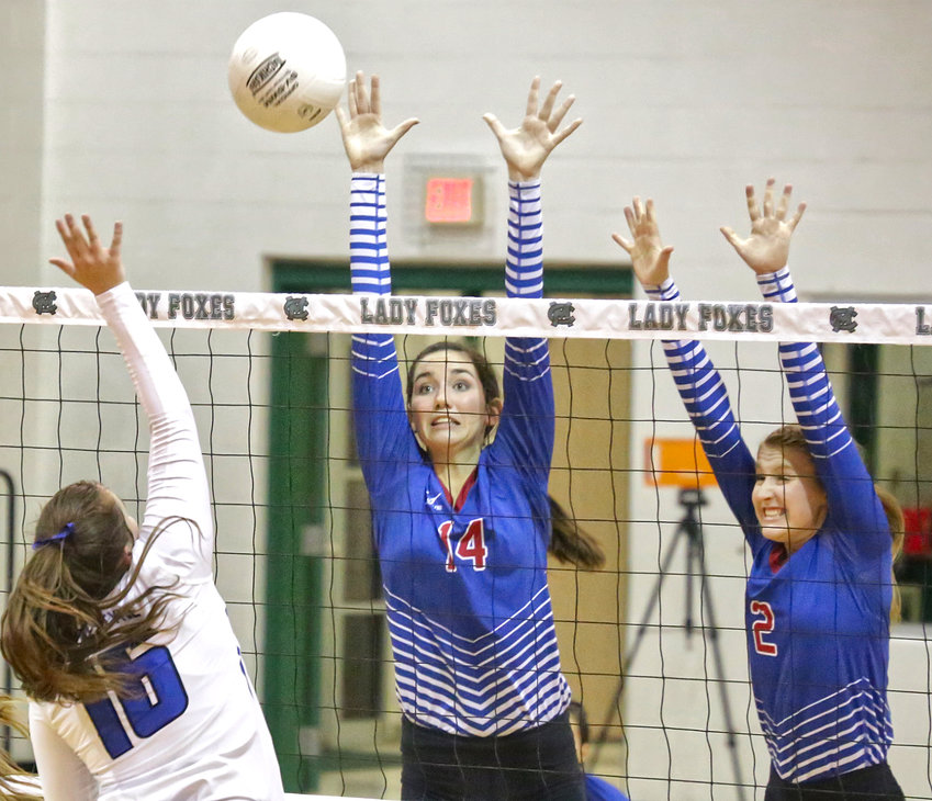 Lady Bulldogs Ava Burroughs and Jentri Jackson defend in the area championship game against Van Alstyne last Friday.