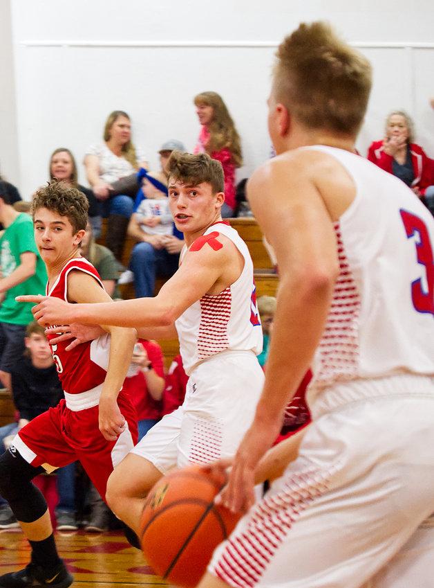 Jon Michael Chadwick eyes his ball-handling teammate Hayden Weissert.