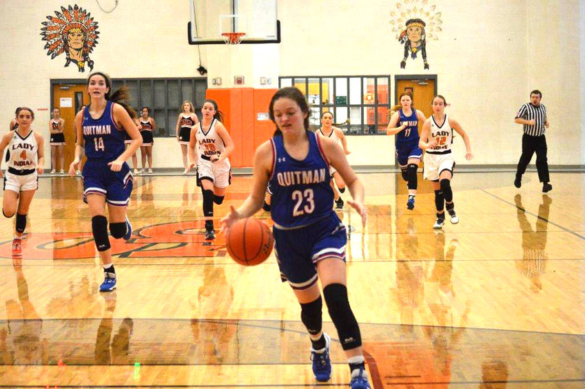 Quitman's Madison Pence (23) drives in to score two of her seven points in the Lady Bulldogs 48-34 win at Grand Saline.