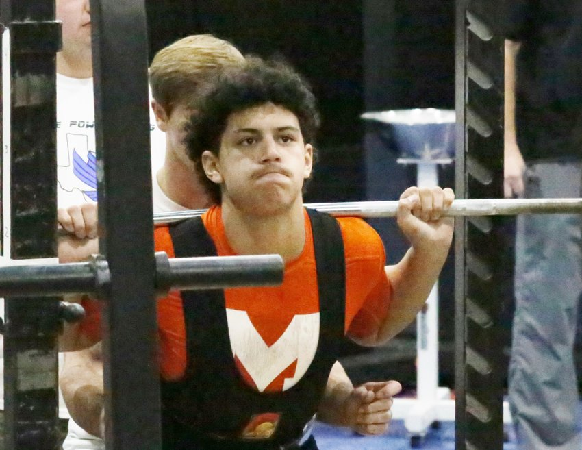 Kobe Kendrick is totally focused on the bar during a lift Saturday in Lindale. He finished sixth in the 198-pound class.