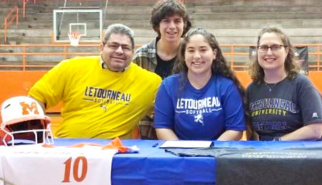 Izzy Tresca is seated between her mother and father, Sarah and Mike Tresca, and joined by her brother Anthony, as she accepts an offer to play softball for Letourneau University.