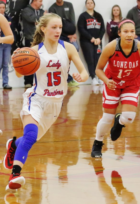 Lady Panther Bella Crawford drives toward a seam in the Lone Oak defense.