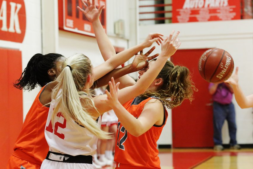 The Mineola press fueled the win at Lone oak last Tuesday. Here Tahjae Black, left, and Cyndi Butler achieve the desired effect.
