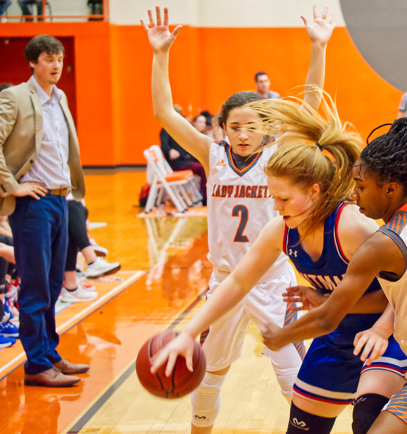 Meghan Brewington (2) and Tahjae Black apply defensive pressure to Quitman guard Shelby Hayes last Friday.