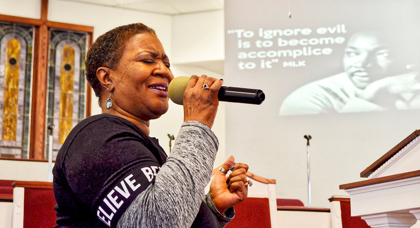 """Sister Kathy Boyd sang heartfelt renditions of """"Jesus Loves Me"""" and """"Amazing Grace"""" at the St. Paul Missionary Baptist Church service honoring Dr. Martin Luther King Jr. Her unbridled passion for Christ could be felt as she sang about grace, liberty and love."""