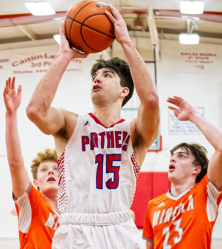 Panther forward Tim Mitchell puts up a shot late in action Fridayat home against Mineola.
