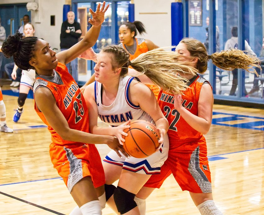 Mineola Lady Jackets Tahjae Black, 23, and Cyndi Butler, 22, trap Kynlee Love of Quitman in last week's cross-county district basketball matchup.