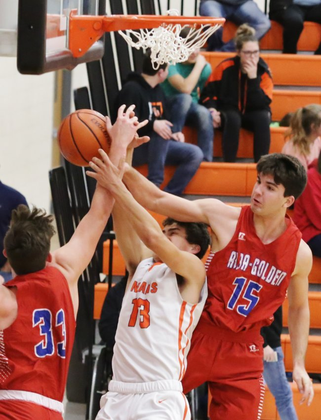 Panthers Tim Mitchell (right) and Boedy Baker team up to deny a fast break lay-in attempt in action against Grand Saline.