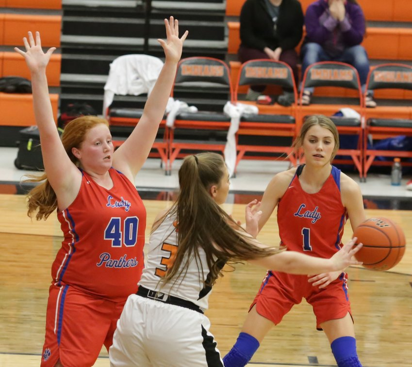 Kylie Kennedy (40) and Crimson Bryant (1) defend in the season-ending contest against Grand Saline.