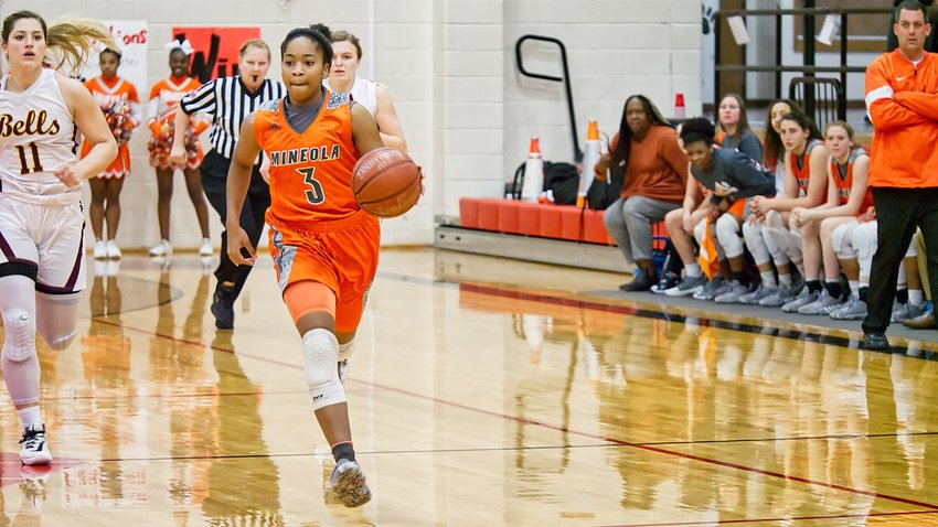 Sabria Dean leads the breakaway on the way to a 49-35 win over Bells.