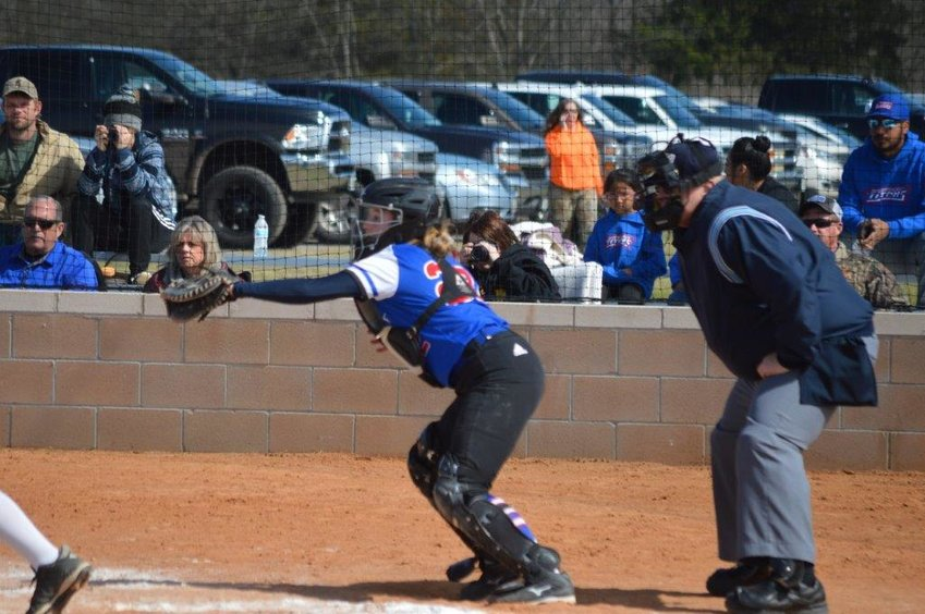 Quitman's Kynlee Love makes a stop from her catcher's position. She delivered the winning hit in a 5-3 win over Bowie Saturday.