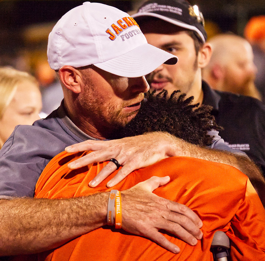 Mineola athletic director Luke Blackwell embraces senior Montrel Williams after a football game Sept. 29 against Big Sandy in which Williams suffered a season-ending injury.