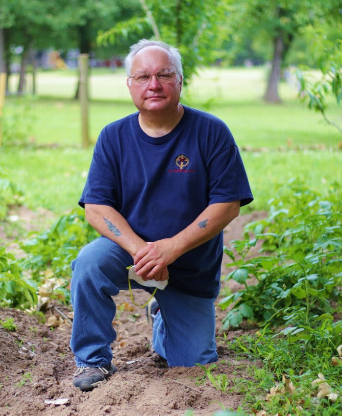 Native gardener Mitchel Bowles among his healthy potato plants.