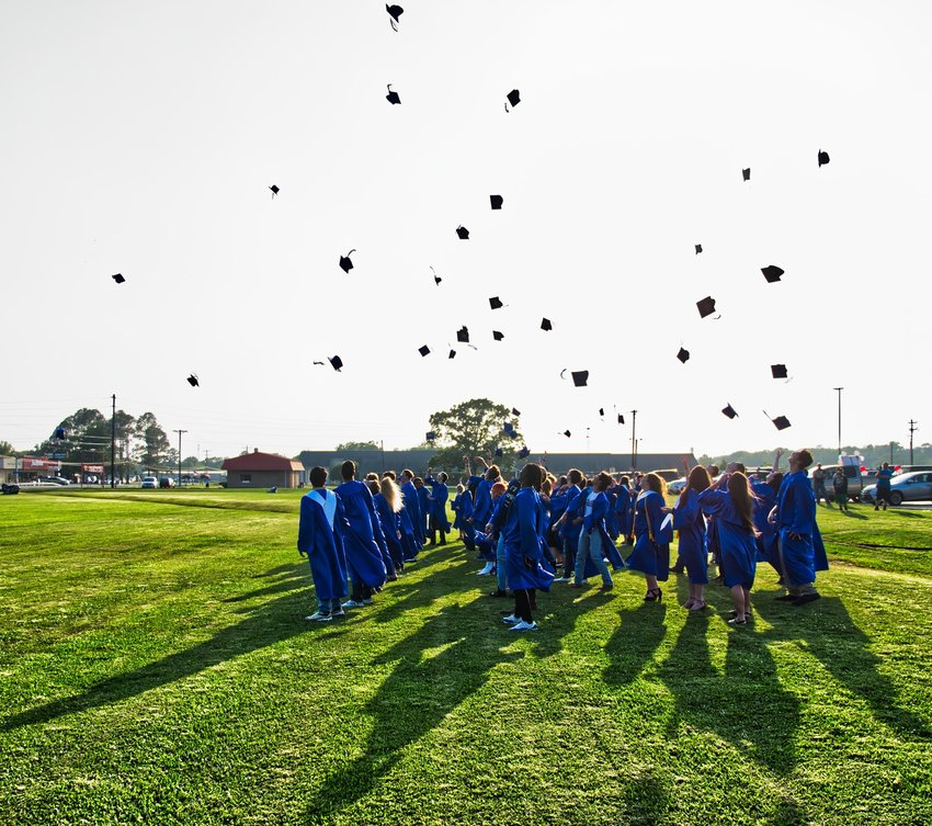 Though much of this May was unlike others, some traditions – like the annual tossing of caps by graduates – remained.