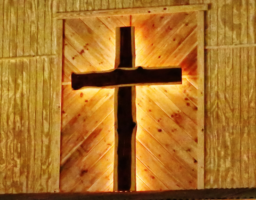 The illuminated cross at Wood County Cowboy Church