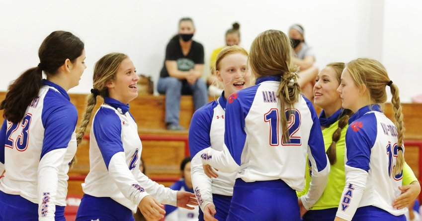 Lady Panthers Autumn Whitten, Skylar West, Kaylee Anglin, Crimson Bryant, Hope Wiley and Cacie Lennon celebrate a point late in the winning match against Union Grove. (Monitor photo by John Arbter)
