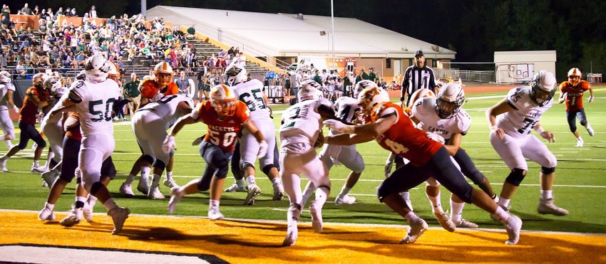 The Mineola defense swarms Canton in the end zone to record a safety, take their first lead and shift all the momentum to the Yellowjackets. Hunter Wright (50) and Kobe Kendrick (24) led the charge.