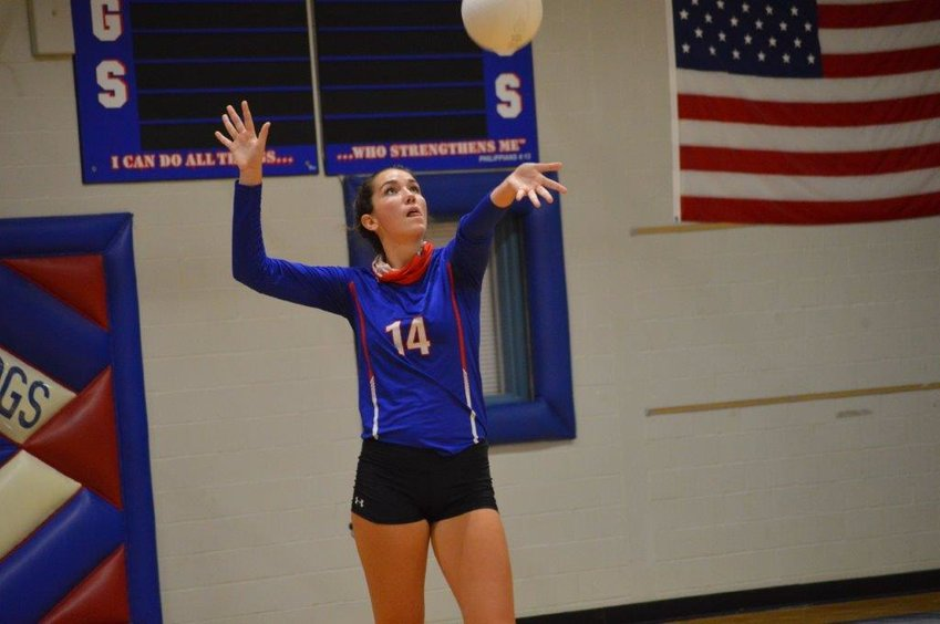 Ava Burroughs gets ready to serve one of her five aces in Quitman's win over Ore City. (Monitor photo by Larry Tucker)