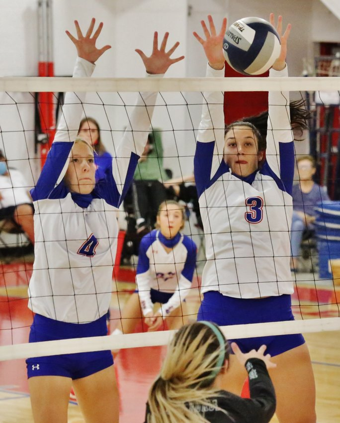 Lady Panther Kalli Wright executes a solid block at the net. Also contesting the shot is Amanda Stewart. (Monitor photo by John Arbter)