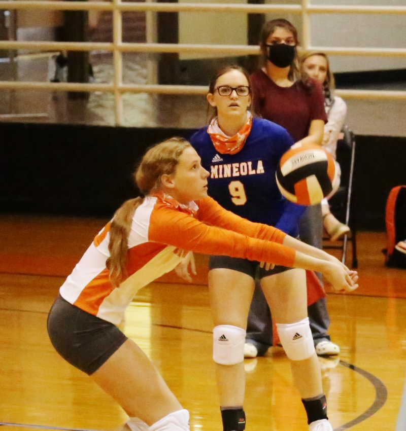 Lady Jacket Mylee Fischer plays the ball from the back line as libero Caidyn Anderson looks on. (Monitor photo by John Arbter)